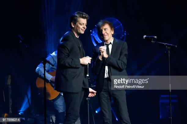 Benjamin Biolay and Alain Souchon perform during the Charity Gala against Alzheimer's disease at Salle Pleyel on February 12 2018 in Paris France