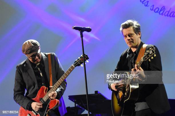 Benjamin Biolay and guitarist Philippe Almosnino performs during 'La Ligue Contre Le Cancer' Celebrates Its 100th Anniversary at Cite des Sciences on...