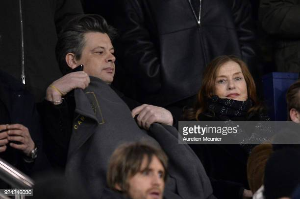 Benjamin Biolay and Isabelle Hupert attend the Ligue 1 match between Paris Saint Germain and Olympique Marseille February 25 2018 in Paris France
