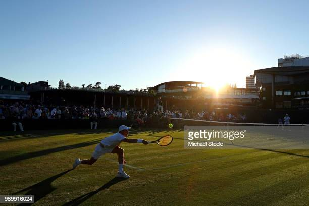 Benjamin Bonzi of France returns a shot to Lukas Lacko of Slovakia on day one of the Wimbledon Lawn Tennis Championships at All England Lawn Tennis...