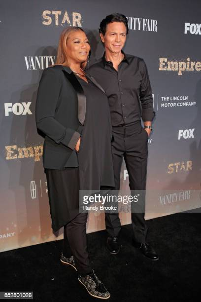 Benjamin Bratt and Queen Latifah pose on the red carpet with her family during the 'Empire' 'Star' Celebrate FOX's New Wednesday Night at One World...