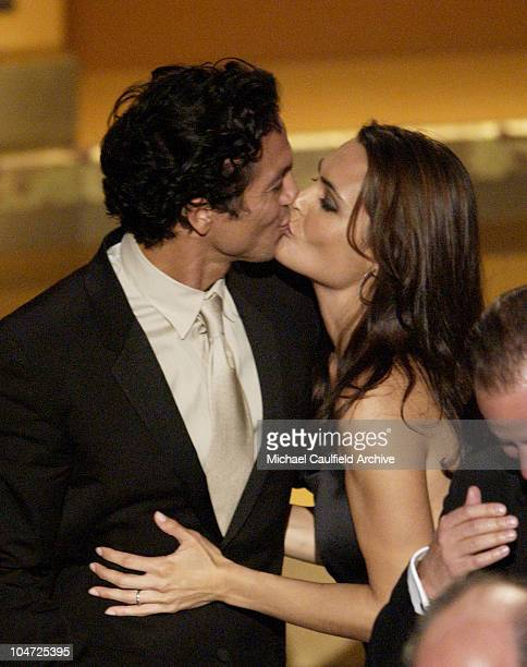 Benjamin Bratt and Talisa Soto kiss while Bratt accepts for Outstanding Motion Picture Pinero