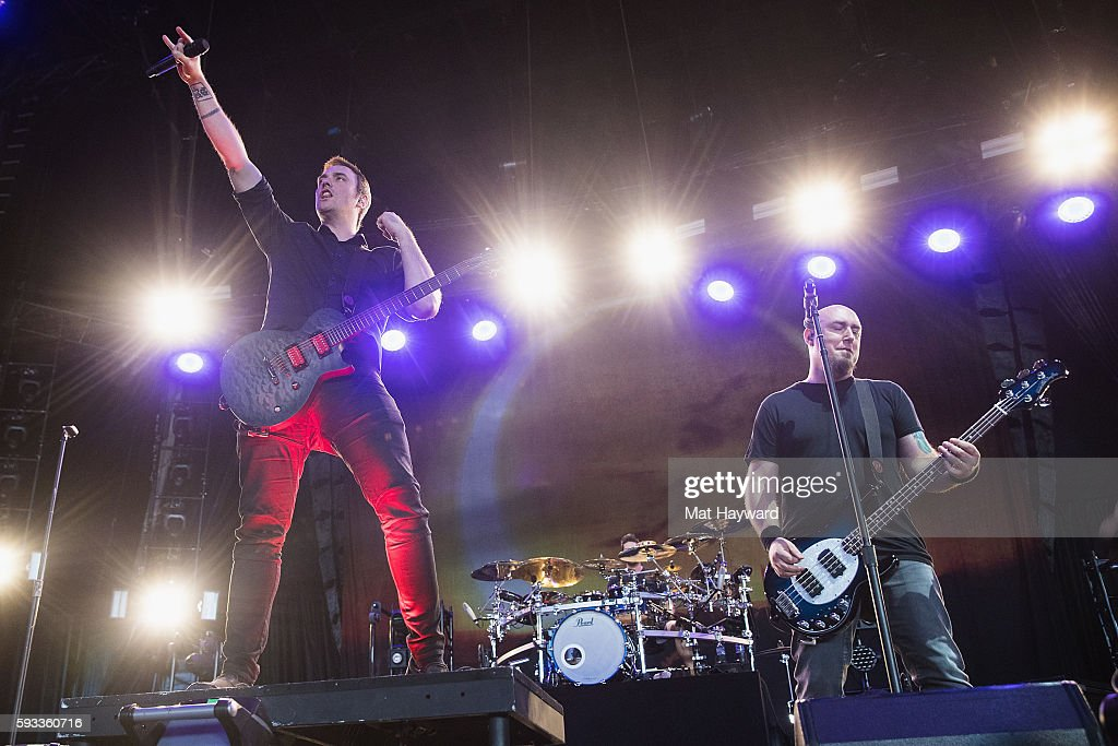 Benjamin Burnley of Breaking Benjamin performs on stage during the Pain In The Grass music festival hosted by 99.8 KISW at White River Amphitheatre on August 21, 2016 in Auburn, Washington.