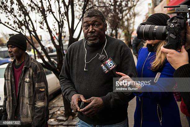 Benjamin Carr father of Eric Garner who was killed by a police officer who put him in a choke hold on July 17 speaks to the media outside the beauty...
