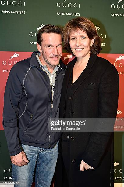 Benjamin Castaldi and Carole Rousseau attend Day 2 of the Gucci Paris Masters 2014 on December 5 2014 in Villepinte France