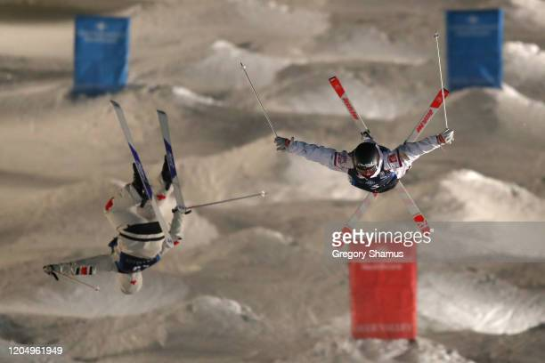 Benjamin Cavet of France competes against Kelly Brenden of Canada during the Men's Dual Moguls at the FIS Freestyle Ski World Cup at Deer Valley on...