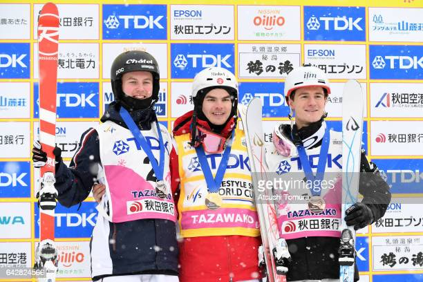 Benjamin Cavet of France Mikael Kingsbury of Canada and Matt Graha of Australia pose with their medals for the men's dual moguls during 2017 FIS...