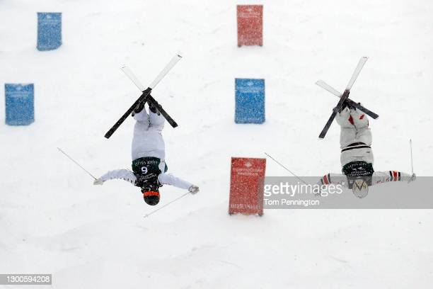 Benjamin Cavet of France skis against Mikael Kingsbury of Canada during a run for the Men's Dual Moguls during the 2021 Intermountain Healthcare...