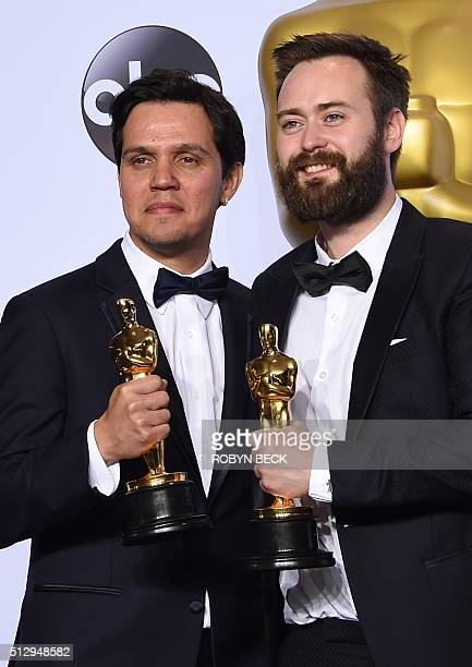 """Benjamin Cleary and Shan Christopher Ogilvie pose with their Oscar for Best Live Action Short Film, """"Stutterer,"""" in the press room during the 88th..."""