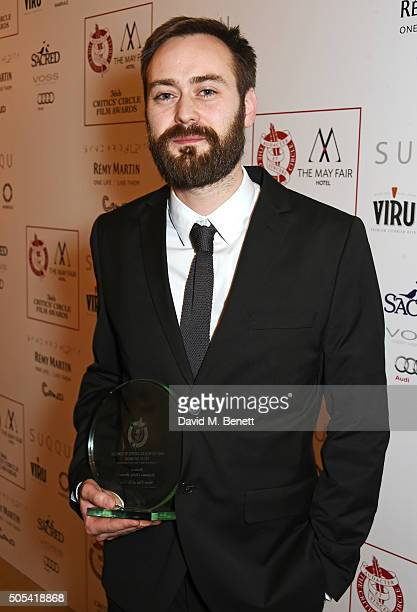 """Benjamin Cleary, winner of the British/Irish Short Film of the Year award for Stutterer"""", poses in front of the Winners Boards at The London Critics'..."""