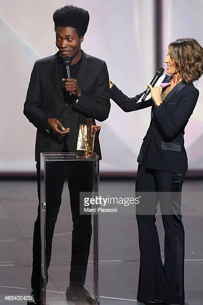 Benjamin Clementine receives from Virginie Guilhaume the stage revelation award during the 30th 'Victoires de la Musique' French Music Awards...