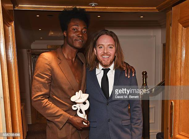 "Benjamin Clementine, winner of the Pop award for ""At Least For Now"", and presenter Tim Minchin pose in the Winner's Room at the The South Bank Sky..."