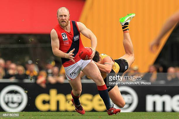 Benjamin Clifton of Coburg is tackled during the round 17 VFL match between Richmond and Coburg at ME Centre on August 16 2015 in Melbourne Australia