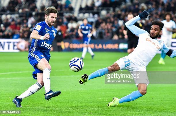 Benjamin Corgnet of Strasbourg and Jordan Amavi of Marseille concedes one penalty during the French League Cup match between Marseille and Strasbourg...
