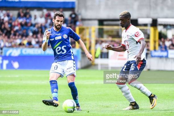 Benjamin Corgnet of Strasbourg and Yves Bissouma of Lille during the Ligue 1 match between Racing Club Strasbourg and Lille OSC at Stade de la Meinau...