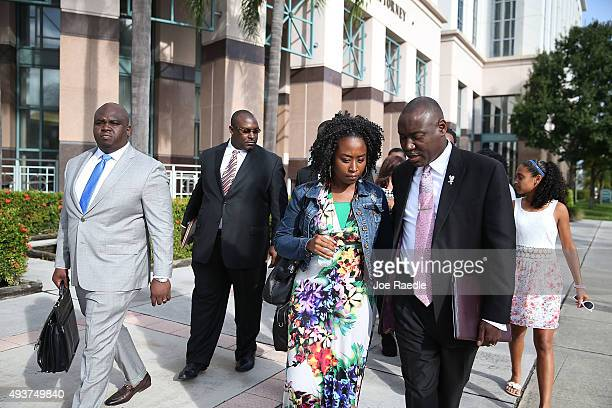 Benjamin Crump an attorney for the Corey Jones' family walks with Melissa Jones as they prepare to speak to the media during a press conference to...