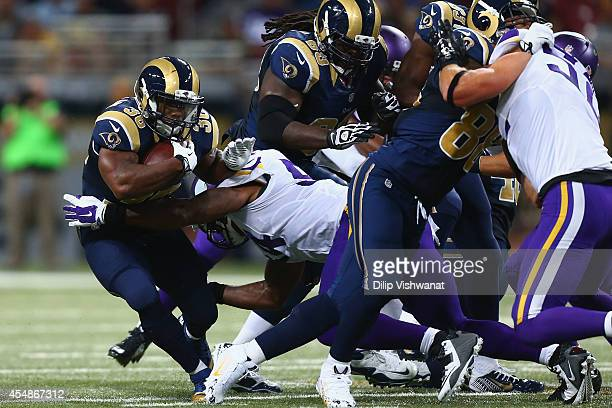 Benjamin Cunningham of the St Louis Rams is tackled by Jasper Brinkley of the Minnesota Vikings at the Edward Jones Dome on September 7 2014 in St...