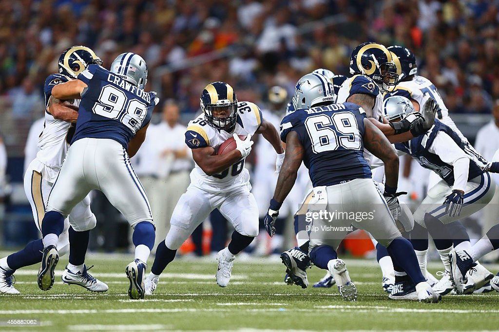 Benjamin Cunningham #36 of the St. Louis Rams rushes against the Dallas Cowboys in the third quarter at the Edward Jones Dome on September 21, 2014 in St. Louis, Missouri. The Cowboys beat the Rams 34-31.