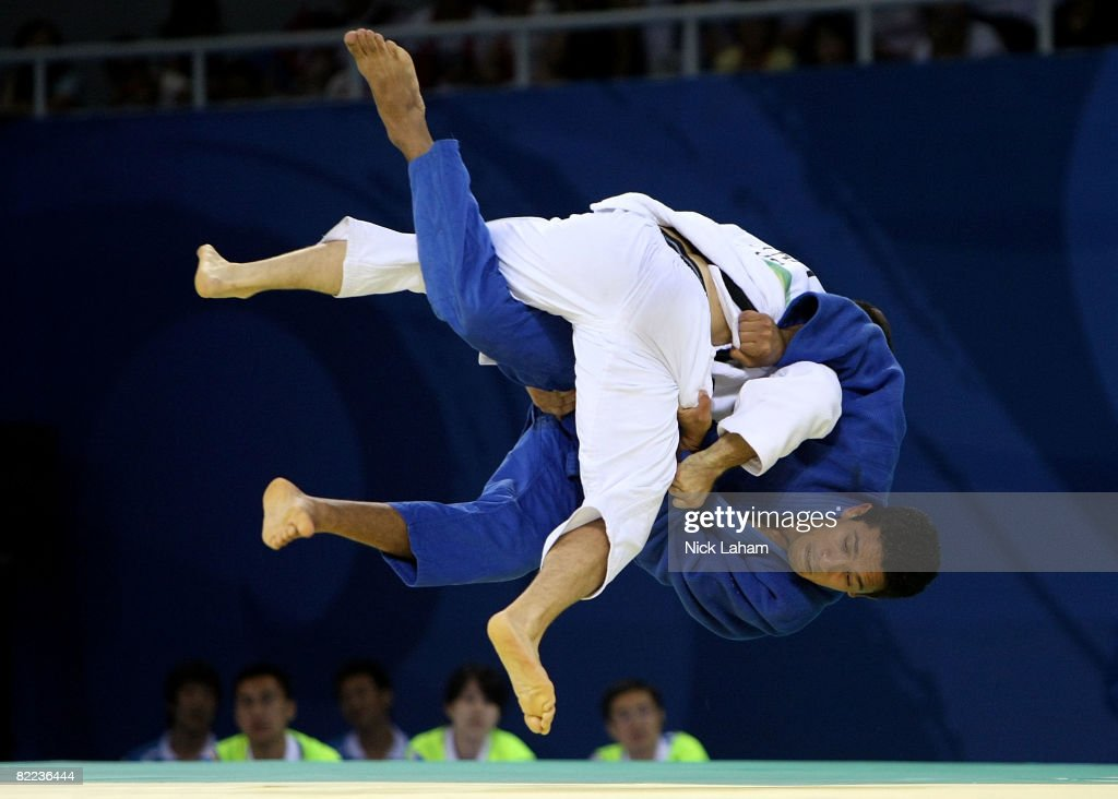 Benjamin Darbelet of France competes against Rachid Rguig of Morocco in their -66 kg men's preliminary judo event held during day 2 of the Beijing 2008 Olympic Games at the University of Science and Technology Beijing Gymnasium on August 10, 2008 in Beijing, China.