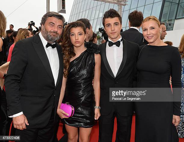 Benjamin Dessange and family attend the Mad Max Fury Road Premiere during the 68th annual Cannes Film Festival on May 14 2015 in Cannes France