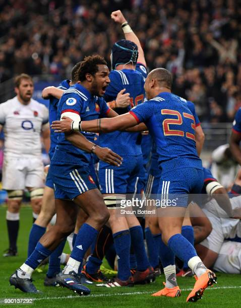Benjamin Fall of France celebrates with teammate Gael Fickou after their victory of the NatWest Six Nations match between France and England at Stade...