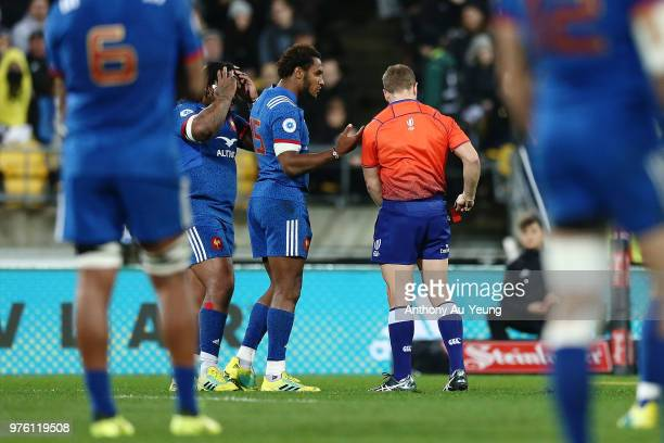 Benjamin Fall of France receives a red card from Referee Angus Gardner as France captain Mathieu Bastareaud reacts during the International Test...