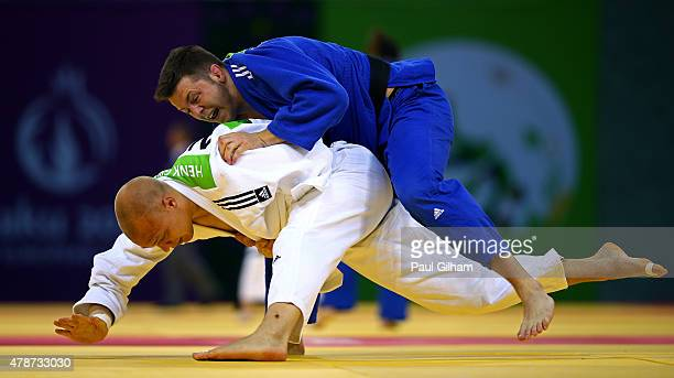 Benjamin Fletcher of Great Britain and Henk Grol of the Netherlands compete in the Men's Judo 100kg round of 16 contest on day fifteen of the Baku...