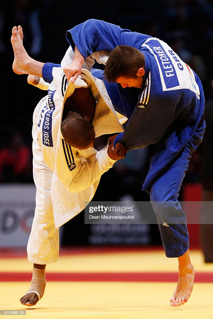 Benjamin	Fletcher (blue top) of Great Britain and Jose Armenteros of Cuba compete during the Dusseldorf Judo Grand Prix in their Mens -100kg bout held at Mitsubishi Electric Halle on February 21, 2016 in Dusseldorf, Germany.