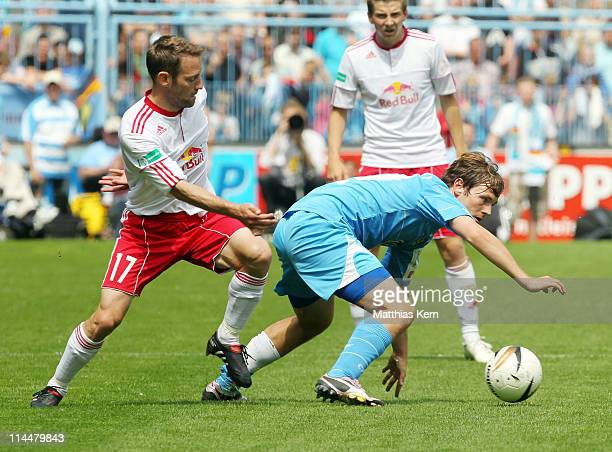 Benjamin Foerster of Chemnitz battles for the ball with Lars Mueller of Leipzig during the Regionalliga North match between Chemnitzer FC and RB...