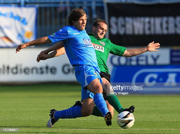 Benjamin Foerster of Chemnitz fights for the ball with Patrick Kirsch of Muenster during the Third League match between Chemnitzer FC and Preussen...