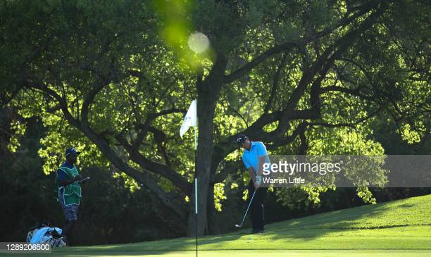 Benjamin Follett-Smith of South Africa plays his chip shot on the 15th hole during Day One of the South African Open at Gary Player CC on December...