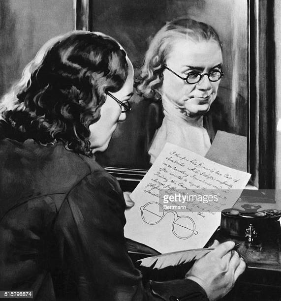 Benjamin Franklin the inventor of bifocals holds a paper with his drawing for the invention His face is seen in a reflection in a mirror as he stands...