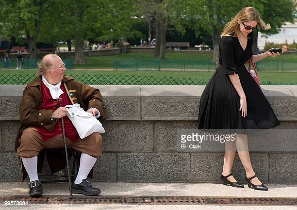Benjamin Franklin watches as a woman tries to keep her skirt down during a gust of wind on the West Front of the Capitol on Thursday April 24 2008 Mr...