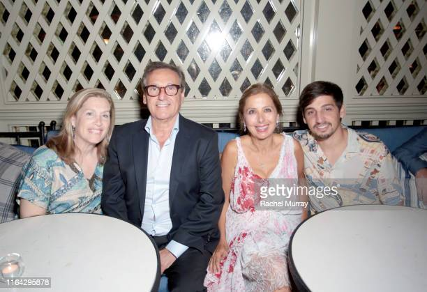 Benjamin Gabbay and Karine Ohana attend the Ohana Co LA Summer Party at the Peninsula Hotel on August 19 2019 in Beverly Hills California