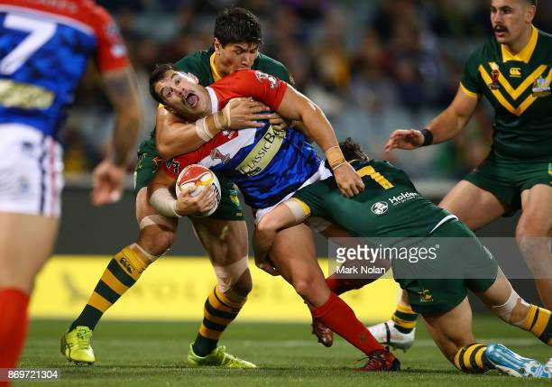Benjamin Garcia of France is tackled during the 2017 Rugby League World Cup match between Australian Kangaroos and France at Canberra Stadium on...