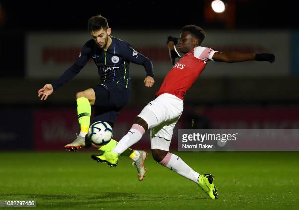 Benjamin Garre of Manchester City battles for posesion with Bukayo Saka of Arsenal during the Premier League 2 match between Arsenal and Manchester...