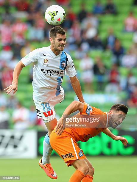 Benjamin Garuccio of City heads the ball over the top of Brandon Borrello of the Roar during the round 10 ALeague match between Melbourne City FC and...