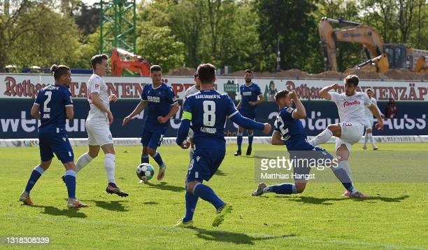 Benjamin Girth of Holstein Kiel scores a goal which was later disallowed due to VAR during the Second Bundesliga match between Karlsruher SC and...