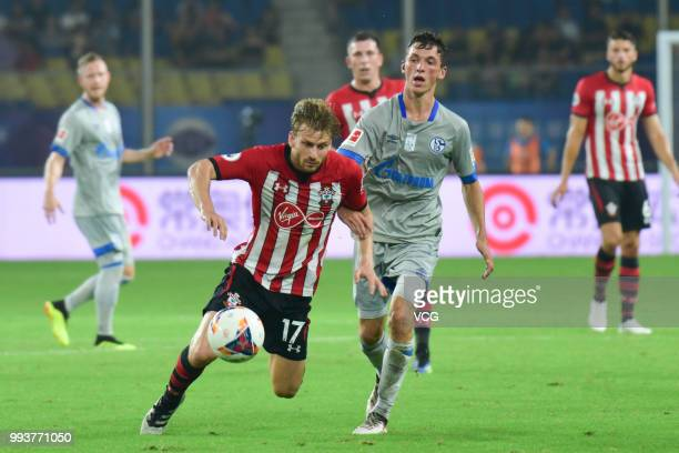 Benjamin Goller of Schalke competes with Stuart Armstrong of Southampton FC during the 2018 Clubs Super Cup match between FC Schalke 04 and...