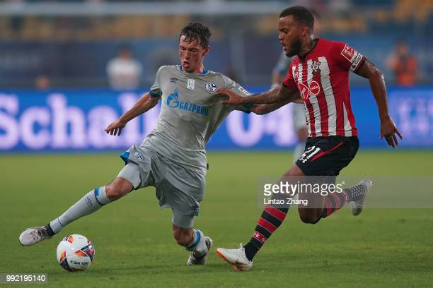 Benjamin Goller of Schalke FC competes the ball with Byan Bertrand of Southampton FC during the 2018 Clubs Super Cup match between Schalke and...