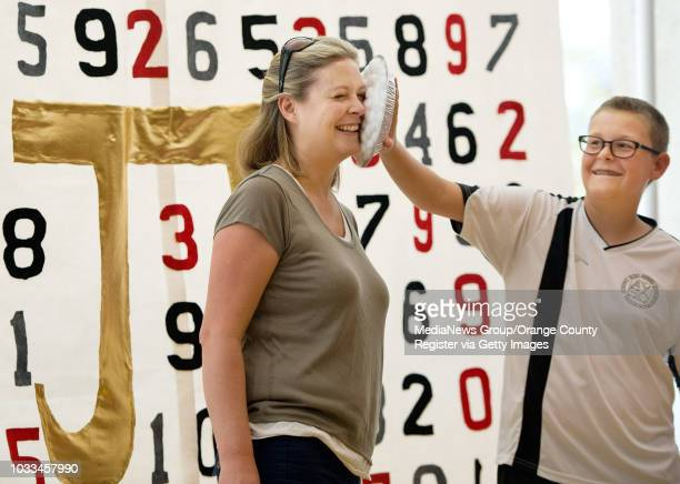 Benjamin Gupton playfully pies his mother Susie's face during Huntington Beach Union High School District's Pi Day celebration at Edison High School...