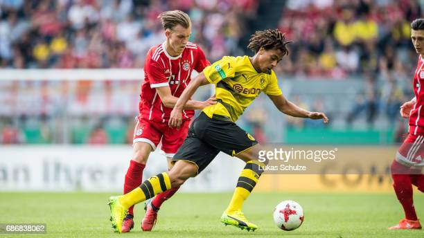 Benjamin Hadzic of Munich and Etienne Amenyido of Dortmund fight for the ball during the U19 German Championship Final between Borussia Dortmund and...