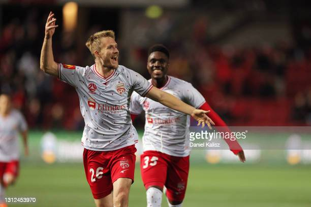 Benjamin Halloran of Adelaide United celebrates after kicking a goal during the A-League match between Adelaide United and Macarthur FC at Coopers...