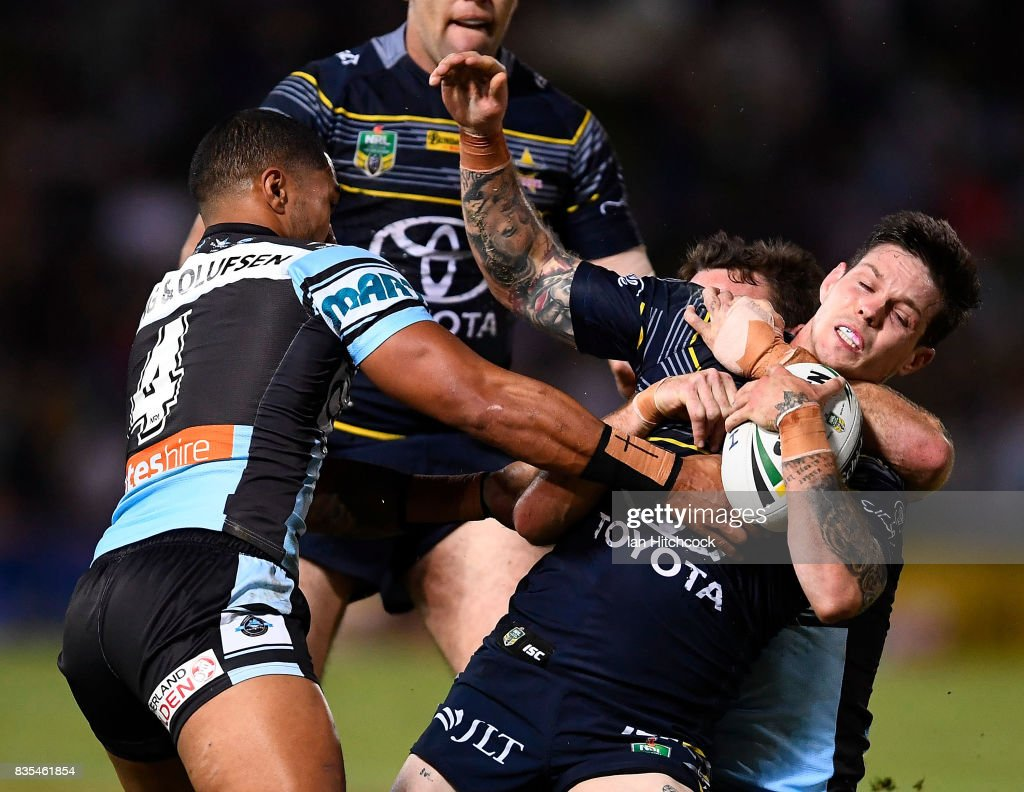 Benjamin Hampton of the Cowboys is tackled by Ricky Leutele of the Sharks during the round 24 NRL match between the North Queensland Cowboys and the Cronulla Sharks at 1300SMILES Stadium on August 19, 2017 in Townsville, Australia.
