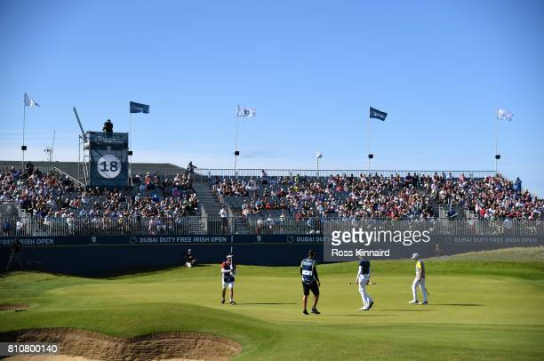 Benjamin Hebert of France celebrates holing a putt on the 18th green during day three of the Dubai Duty Free Irish Open at Portstewart Golf Club on...