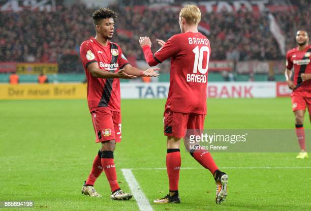 Benjamin Henrichs and Julian Brandt of Bayer 04 Leverkusen celebrate after scoring the goal 10 during the DFBPokal match betweenBayer 04 Leverkusen...