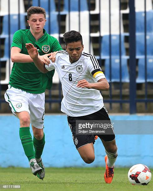 Benjamin Henrichs is challenged by Georgie Poynton of Ireland during the UEFA Under17 Elite Round between Germany and Ireland at Stadion FC Obilic on...