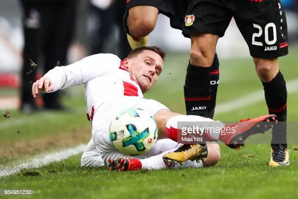 Benjamin Henrichs of Bayer Leverkusen Charles Aranguiz of Bayer Leverkusen and Christian Clemens of 1FC Koeln battle for the ball during the...