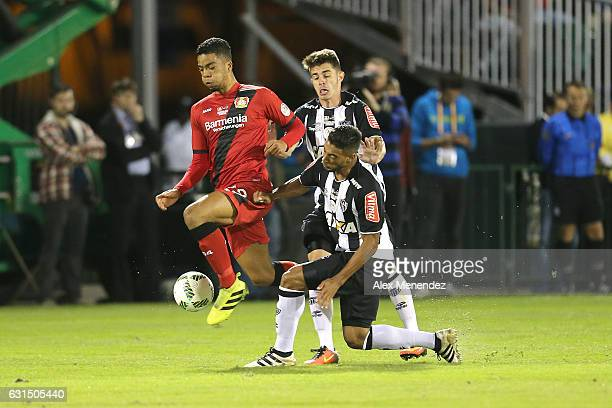 Benjamin Henrichs of Bayer Leverkusen leaps past a falling Nathan of Atletico Mineiro at ESPN Wide World of Sports Complex on January 11 2017 in...