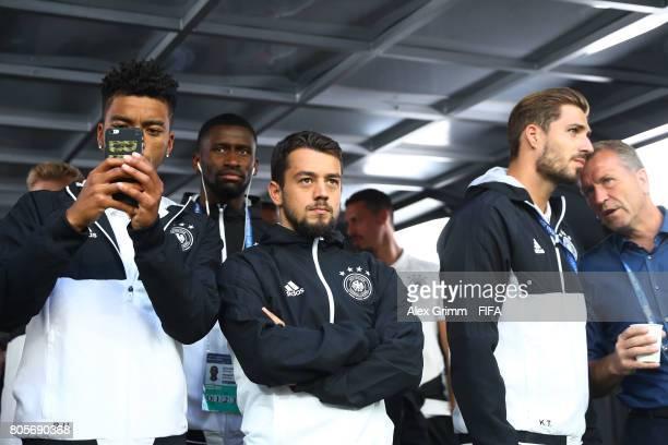 Benjamin Henrichs of Germany Antonio Ruediger of Germany and Amin Younes of Germany watch the closing ceremony prior to the FIFA Confederations Cup...